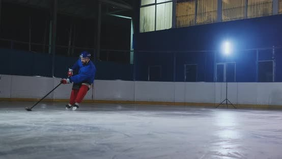 Thumbnail for Hockey Forward Carrying a Puck, Skating Past an Opposing Defenseman and Taking a Slap Shot