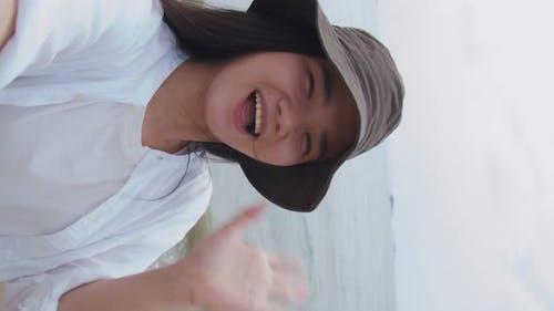 Smiling Asian female celebration enjoyment on holiday summer.