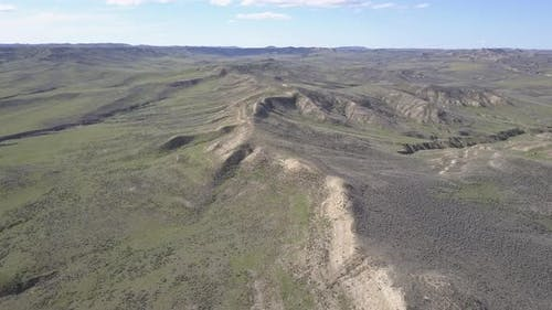 Drone Ascending Prairie Grassland in Spring with Ridge Great Plains Landform Wyoming United States