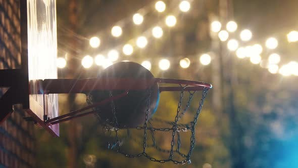 Thumbnail for Basketball Ball Getting in the Hoop on Outdoor Playground