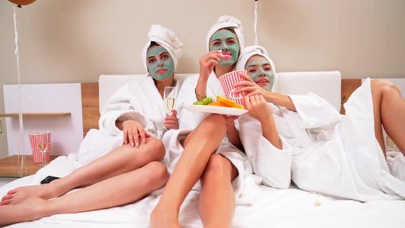 Thumbnail for Girls Watching Movie in Bed and Laughing.