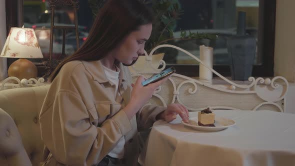 Thumbnail for Young Pretty Girl Taking Photos on Smartphone of Fresh Mouth-watering Cake with Decorations on the
