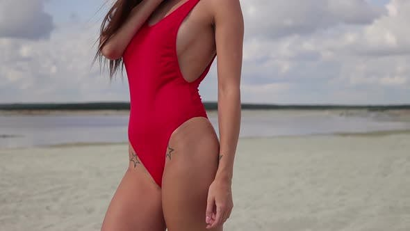Thumbnail for Sensual Woman in Red Bikini Standing and Enjoying Sunshine