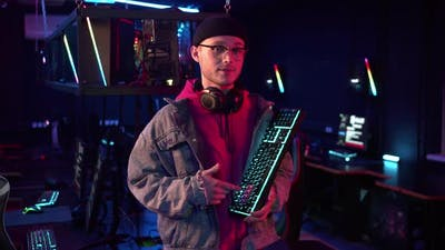 After the Online Video Game Tournament the Gamer Talks About the Advantages of the New Keyboard and