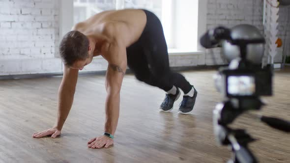 Thumbnail for Shirtless Fitness Coach Showing Running Plank on Camera