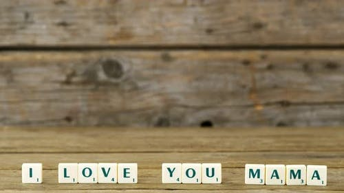 I love you mama block on wooden background