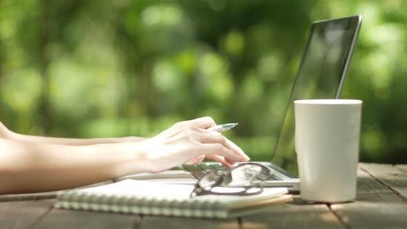 Thumbnail for Using Laptop At Garden