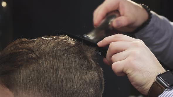 Thumbnail for Barber Cutting Hair of His Client with a Trimmer