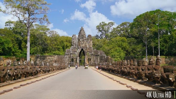 Thumbnail for 4K Bayon Angkor Thom Entrance Gate as Tourists Walk and Ride by