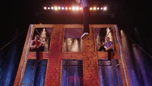 Acrobatic performance on trampoline in the circus
