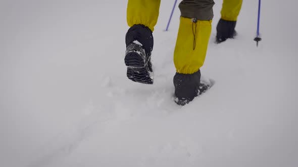 Thumbnail for Two Men Went on an Expedition. Professional Trekking Boots and Leggings Help To Move in the Snow.