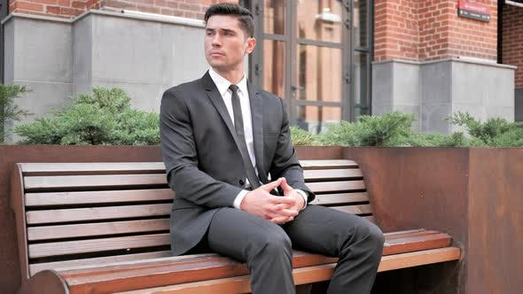 Thumbnail for Businessman Sitting Outdoor on Bench