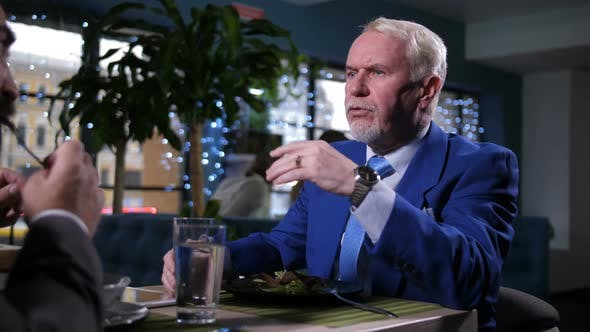 Cover Image for Portrait of Businessman at Lunch in Restaurant