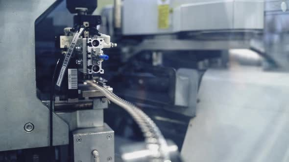 Close up of industrial machine. Close up view of production machine operation