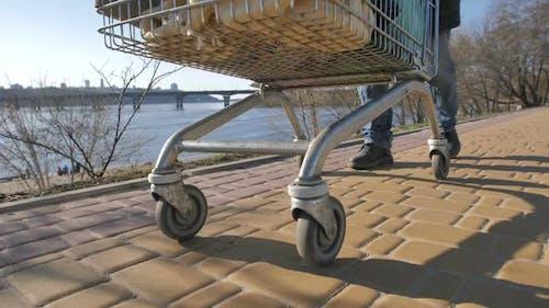 Wheels of Cart with Homeless Man's Belongings