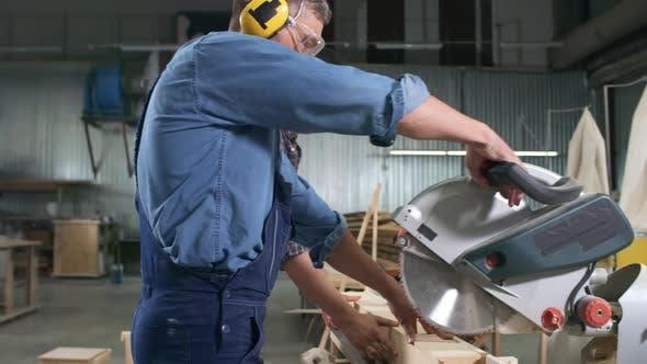 Thumbnail for Carpenter Using Circular Saw