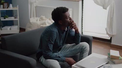 Portrait of Pensive Thoughtful African American Man Looking Out the Window