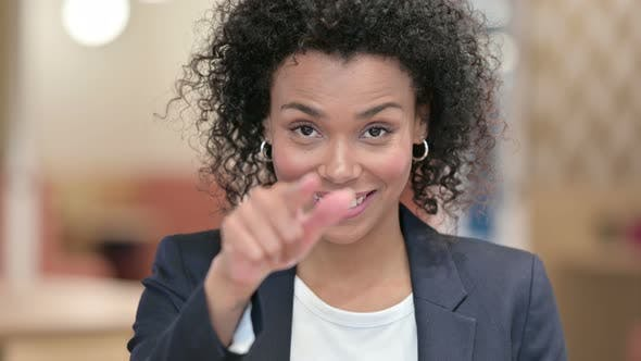 Thumbnail for African Businesswoman with Pointing Finger and Inviting