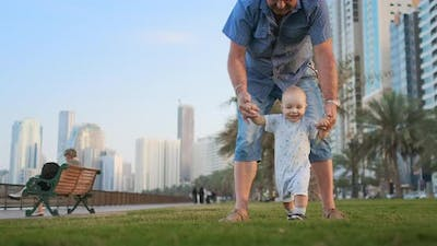 Young Father with a Child and First Steps. Young Father with a Child at Outdoor Learninig for a