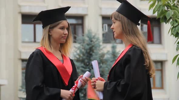 Thumbnail for Happy Smiling Graduates Chatting Near Academy and Holding Diplomas, Conversation