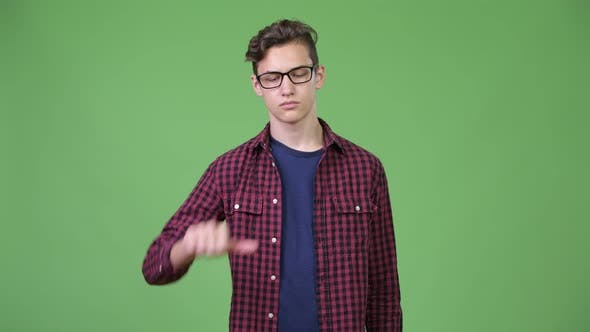 Cover Image for Young Handsome Teenage Nerd Boy Giving Thumbs Down