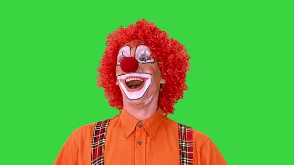 Happy Walking Clown Looking To the Sides on a Green Screen, Chroma Key.