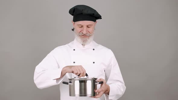 Professional Chef with a Pot on Grey Copy Space