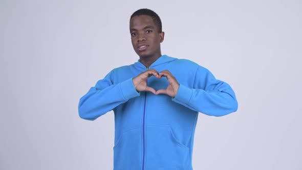 Cover Image for Young Happy African Man with Hand Heart Gesture