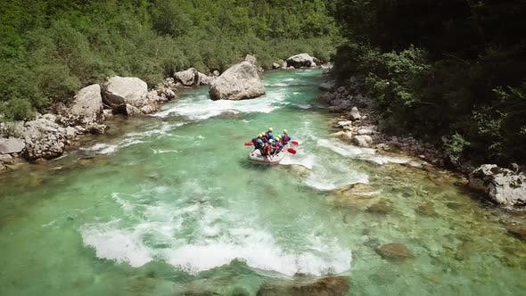 Thumbnail for Aerial view of a group in a rafting boat going through the rocks at Soca River.