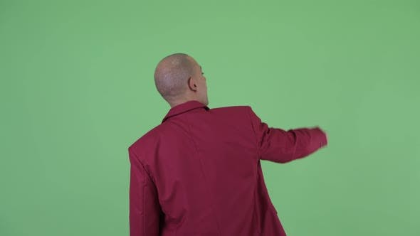 Thumbnail for Rear View of Bald Multi Ethnic Businessman Pointing Finger