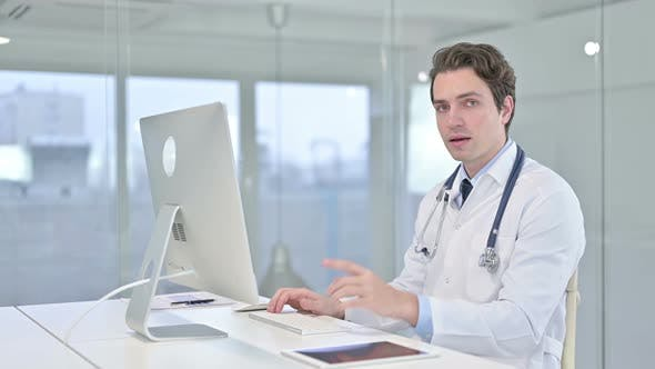 Thumbnail for Cheerful Young Male Doctor Pointing Finger at Camera