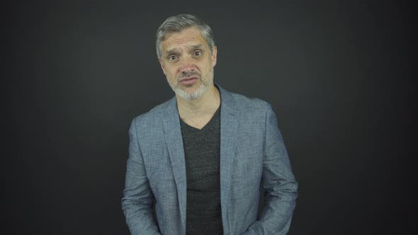 Thumbnail for Mature Actor with Grey Hair and Beard Looks Straight Talking
