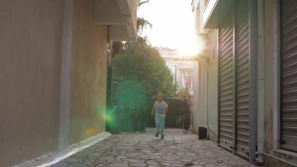 Happy child running in the street