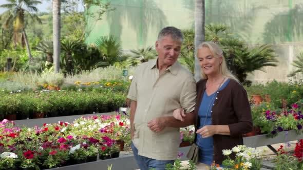 Thumbnail for Mature couple walking through garden centre