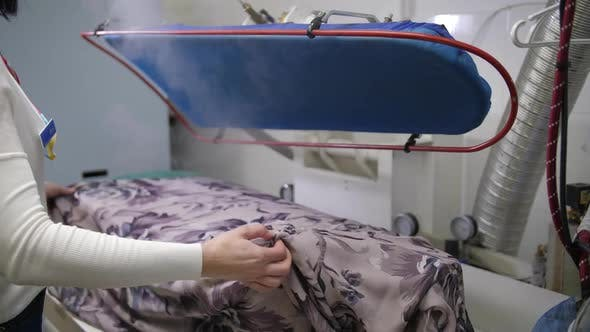 Thumbnail for Steaming of Clothes Lying on Special Machine