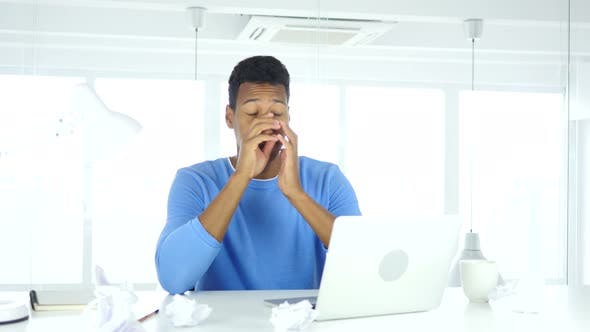 Cover Image for Afro-American Man Frustrated with Paperwork at Work