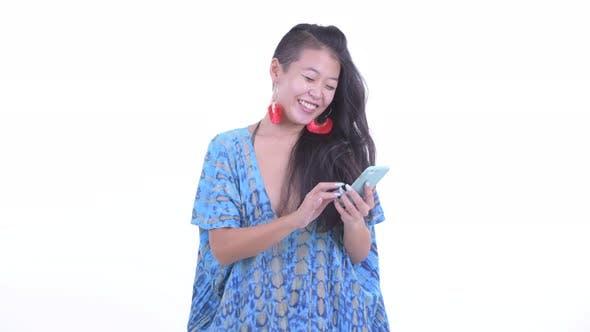 Thumbnail for Happy Beautiful Asian Tourist Woman Using Phone