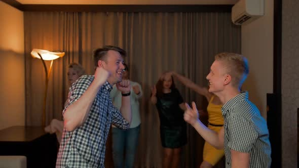 Thumbnail for Two Guys and Their Friends Dancing at Home Party