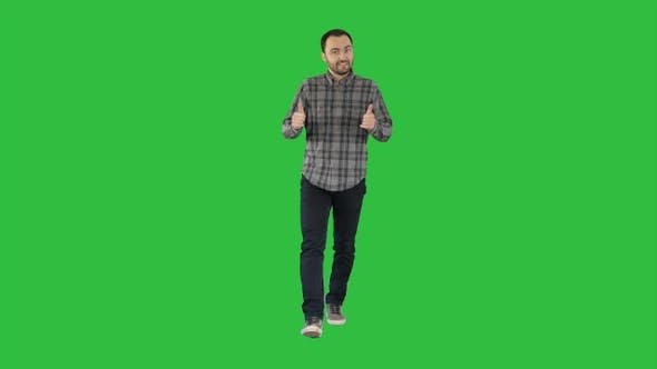 Thumbnail for Walking man pointing and explaining something on a Green
