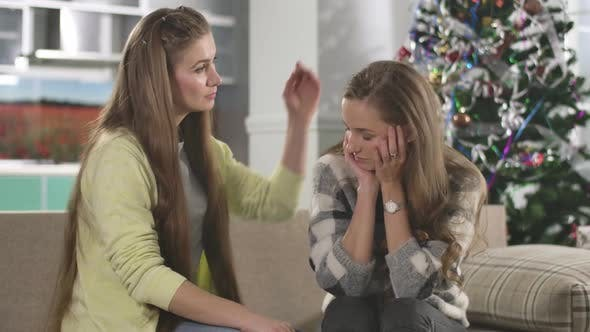 Thumbnail for Young Caucasian Woman Calming Down Friend on Christmas Eve. Portrait of Brunette Lady Supporting