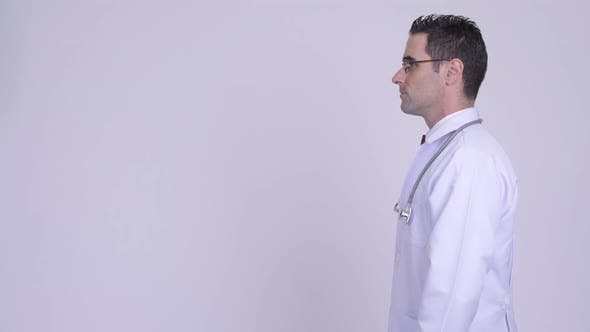 Thumbnail for Profile View of Handsome Man Doctor Wearing Eyeglasses Against White Background