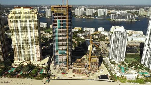 Highrise condo under construction aerial drone video