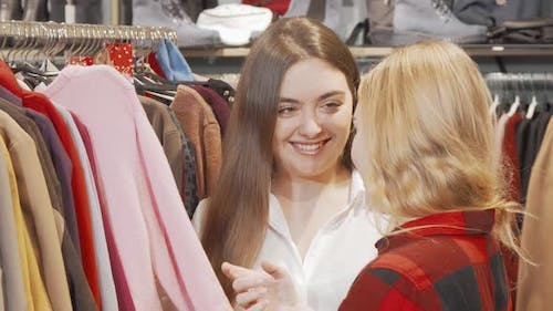 Two Female Friends Shopping Together at Clothing Store