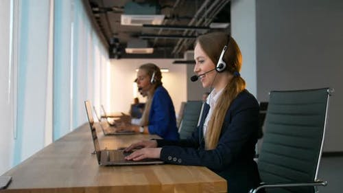 Call-center Female Consultant Have Deal with Customers