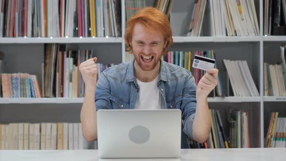 Thumbnail for Successful Online Payment by Redhead Man in Office
