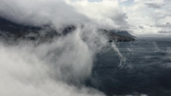 Thumbnail for Lush Mountainside Behind Thick Fog and Rippling Ocean Waters in Foreground