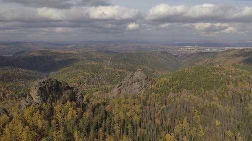 Aerial View of Autumn Forest and Granite Rocks in the Siberian Nature Reserve Stolby.
