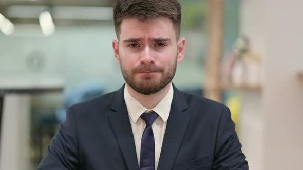 Thumbnail for Upset Young Businessman Crying at the Camera