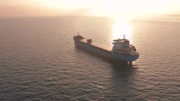 Thumbnail for Aerial View. Beatiful Sunset at the Sea. Huge Cargo Ship Floating in the Sea