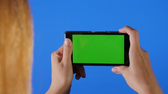 Thumbnail for Taking photos on smart phone chroma blue and green screen 4K 2160p UHD footage - Chroma screen woman